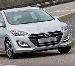 gray i30 Hyundai in motion